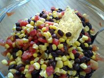 Corn and black bean salsa. This big, colorful bowl of salsa will make a super spicy background stock image
