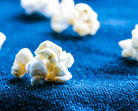 The corn of the blue screens. Macro shot of popcorn in blue background Royalty Free Stock Photo