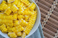 Corn Boil a cup of white bands on the bamboo floor. Royalty Free Stock Photos