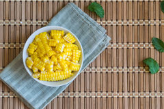 Corn Boil a cup of white bands on the bamboo floor. Stock Images