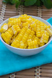 Corn Boil a cup of white bands on the bamboo floor. Stock Photo