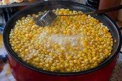 Corn boil hot, add sugar, milk, butter and delicious. Corn boil hot, add sugar, milk, butter and delicious ,useful Stock Image