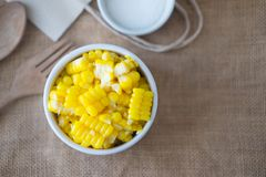 Corn boil slices is delicious. In white bowl for cooking stock photos
