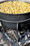 Corn boiling in the very big kettle Stock Photography