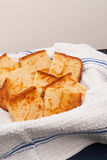 Corn Bread. Homemade corn bread served on a white dish towel. Neutral background for your own copy or replace Royalty Free Stock Photography