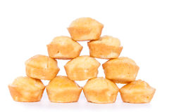 Corn bread muffins. Pyramid of corn bread muffins, isolated on white background Royalty Free Stock Images