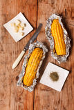 Corn with butter Stock Images