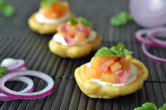 Corn cakes with mango salsa. Mini corn cakes with spicy mango salsa Stock Photography