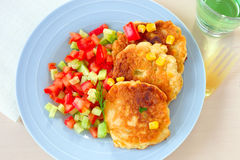 Corn cakes with salsa. Corn cakes with cucumber and tomato salsa royalty free stock photo