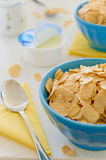 Corn cereals with greek yogurt in blue ceramic pot. Cornflake cereals with greek yogurt in blue ceramic pot on the side with open yogurt and yellow napkins in Stock Photo