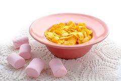 Corn cereals with marshmallows. Corn cereals in the pink plate with marshmallows Royalty Free Stock Image