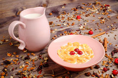 Corn cereals with milk. Corn cereals in the pink plate with milk Stock Photo