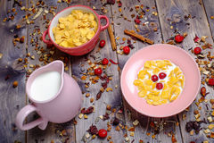Corn cereals with milk. Corn cereals in the pink plate with milk Royalty Free Stock Photography