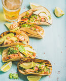 Corn chicken and avocado tortillas, beer in glass, copy space Royalty Free Stock Image