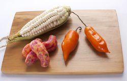 Corn,chili and olluco. Precolumbian Peruvian ingredients on table Stock Photos