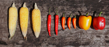 Corn chilly paprika on wood table Stock Photography