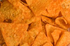 Corn Chips Background. A plate of corn chips close up as a background Stock Photos