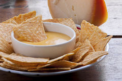 Corn chips. And cheese sauce stock image