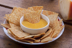 Corn chips. And cheese sauce Stock Images