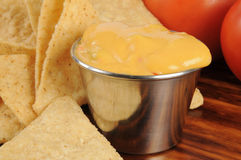Corn chips and cheese sauce Royalty Free Stock Photo