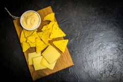 Corn chips with cheese sauce. Place for your text stock images