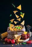 Corn chips falling in paper box stock photos