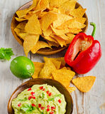 Corn chips and guacamole Stock Photos