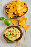 Corn chips and guacamole Royalty Free Stock Photo