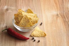 Corn chips in the jar. Traditional snack for beer Mexican nachos royalty free stock images