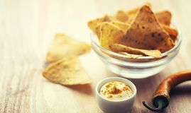 Corn chips in the jar. Traditional snack for beer Mexican nachos stock photography