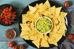 Corn chips nachos on a green blue wooden background. Top view. Mexican food. stock photography