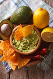Corn chips, sauce guacamole and ingredients closeup. vertical Royalty Free Stock Image