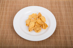 Corn Chips on White Plate and Bamboo Placemat stock images