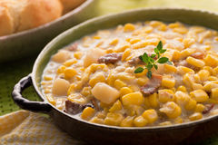 Corn Chowder. A bowl of homemade corn chowder with bacon, potato, and cheese biscuits Stock Photo