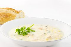 Corn Chowder and Bread. A bowl of chicken corn chowder with bread for lunch or dinner on a cold winter day Stock Photography