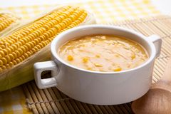 Corn Chowder. And fresh corn on wood butcher Royalty Free Stock Images