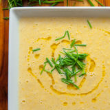 Corn chowder. Delicious sweet corn chowder served with fresh chives Royalty Free Stock Image