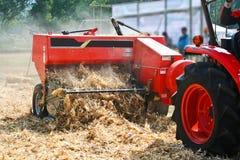 Corn cob briquette and tractor orange color Stock Photo