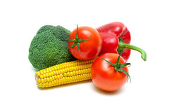 Corn on the cob, broccoli, cherry tomatoes and sweet peppers on Royalty Free Stock Photography