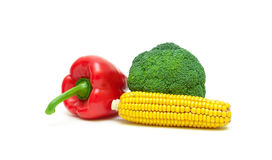 Corn on the cob, broccoli and sweet peppers on white background Royalty Free Stock Photos