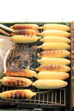 Corn on the Cob grilling Royalty Free Stock Photos