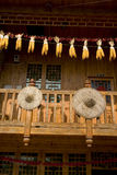 Corn cob hung in wooden house. Yellow corn cob and red hot pepper hung in wooden house,in China Stock Photography