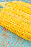 Corn cob on rustic wooden table Stock Image