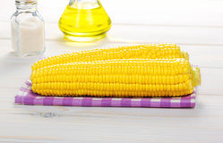 Corn on the cob on a wooden table Stock Photography