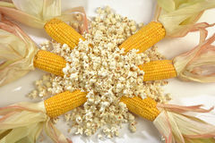Corn cobs with over a pile of popcorn Royalty Free Stock Photo