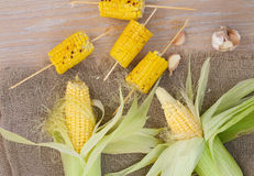 Corn cobs on a sackcloth Stock Images