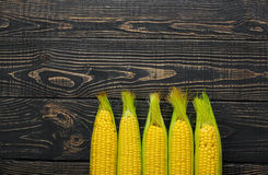 Corn cobs on vintage wood as background Royalty Free Stock Photos