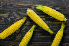 Corn cobs on vintage wood as background Stock Images