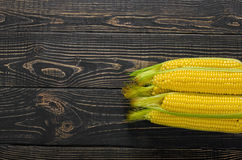 Corn cobs on vintage wood as background Royalty Free Stock Image