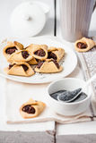 Corn cookies with paste from poppy seeds and dried fruit, select Stock Photography